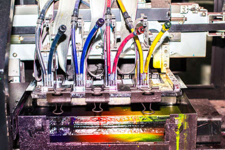Close-up of inkjet printers in large machines.