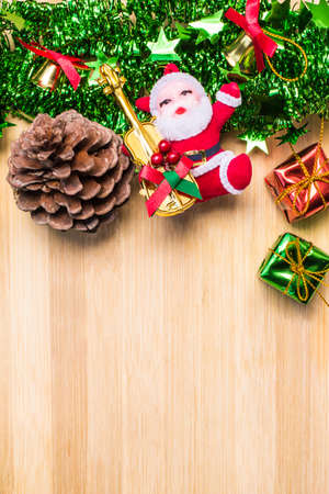 freeing: Christmas symbols colorful stars and colored bell with a wooden texture, freeing space for ideas Happy New Year holiday. Stock Photo