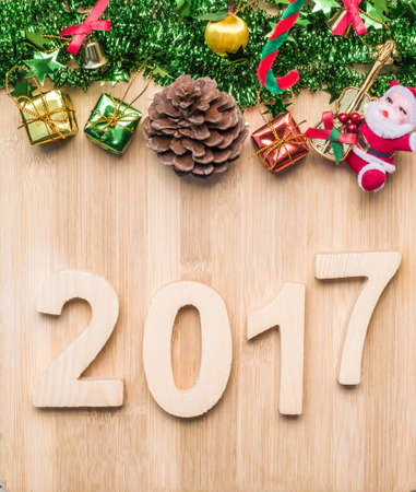 freeing: Christmas symbols colorful stars and colored bell with a wooden texture, freeing space for ideas Happy New Year 2017 holiday.