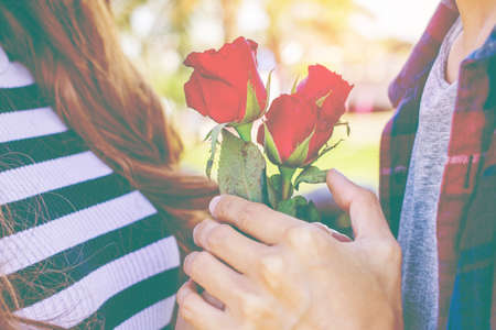 Men give women rose on Valentine's day.