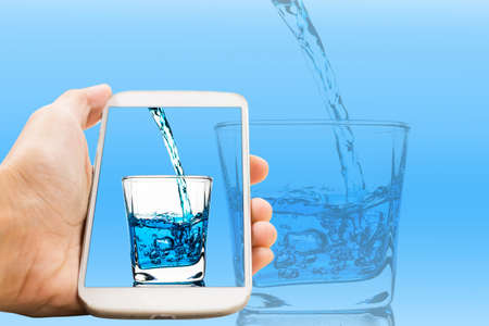 Handle phone has poured a glass of water Concept ideas
