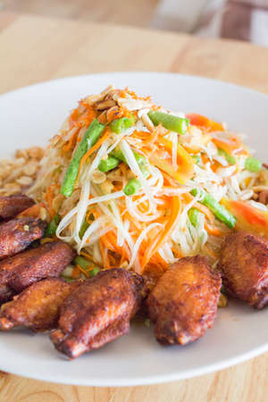 Papaya salad in dish on the table of wood. Stock Photo