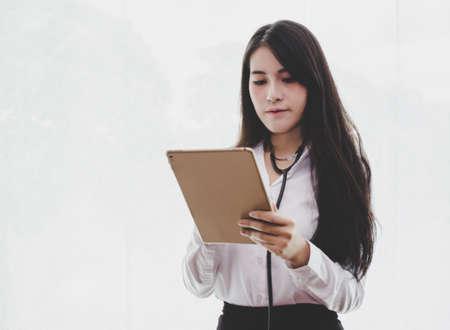 Soft focus blur.Asian woman Doctor using tablet.Healthcare Medicine Concept Stock Photo