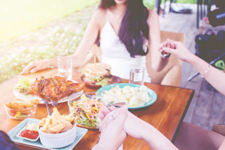 Close-up,Asain hand thanking to God before eating food on table on Thanksgiving Day