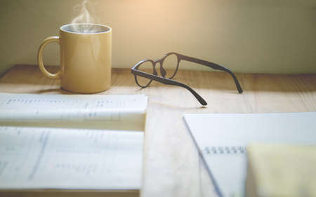 Coffee cups and glasses  on the table With Sunset Light Background, Selective focus