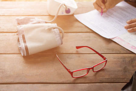 Red glasses with  Blood Pressure Monitors with Blood Pressure Monitors, Cancer Patients at home