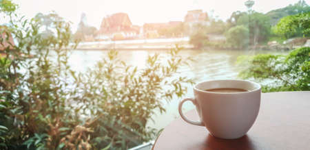 cup of hot coffee  and smoke on table in the morning. copyspace for your text