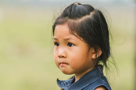 Portrait, standing, or the Asian girls, sad faces.