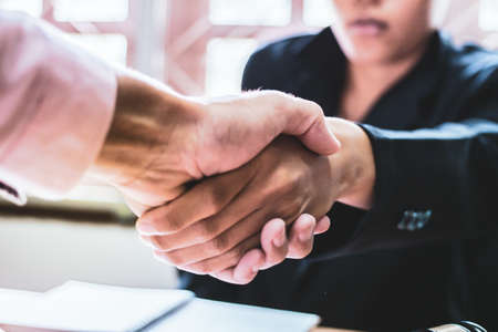 Close-up Shake hands lawyers in office. Counseling and Give an advice between private and government officials to find a fair settlement.  style filter Stock Photo