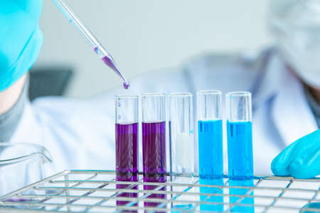 Close up. Medical or science medical in laboratory room research performs tests with liquid, Experimental Drug Treatment Stock Photo