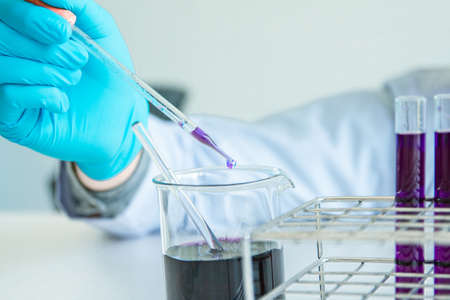 Close up. Medical or science medical in laboratory room research performs tests with liquid, Experimental Drug Treatment 写真素材