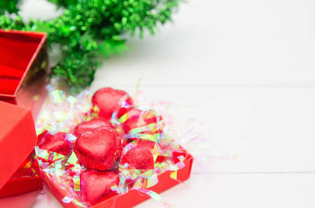 Set Red heart of Chocolate in box , sweet candy on white wooden background for Valentines Day.Copy space for your text