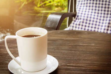 cup of hot coffee with smoke on table in the morning. copyspace for your text