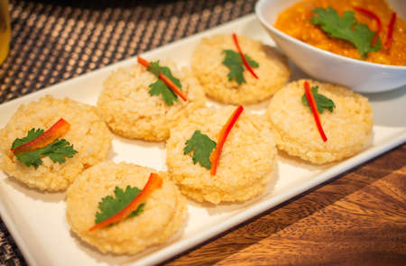 Rice Cracker with Dipping Sauce on table