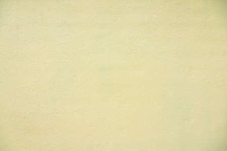 Fond de texture de mur de ciment jaune