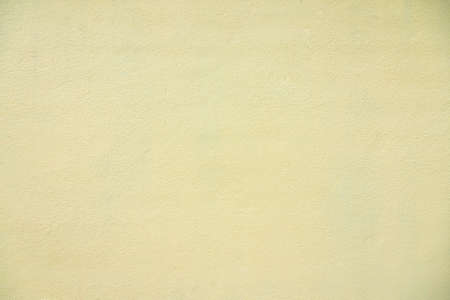 Yellow cement wall texture background