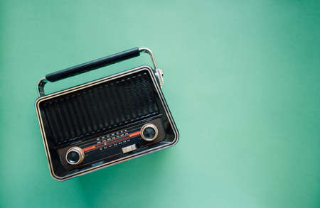Retro style old boombox radio from 1950s, 1960s on green pastel paper background and Vintage tone style filter photo Banque d'images