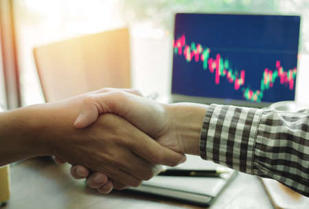 Close-up Business people shaking hands  partnership meeting Investment Trade Stocks market on office.