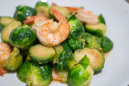Close up, Fried Brussels Sprouts or Brassica oleracea  with fresh shrimp on plate