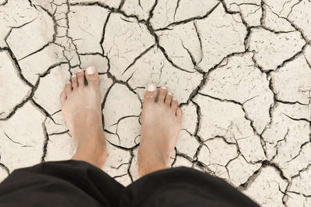 Feet on the dry ground Human Global Warming Situation. Stock Photo