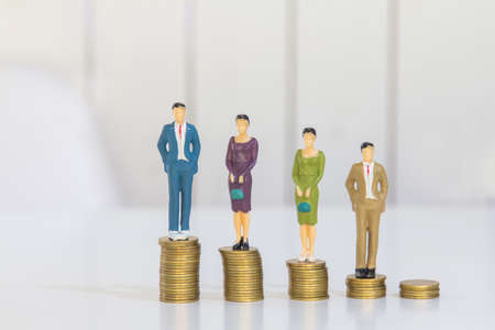 Success people miniature business, businessman and woman teamwork on top of the money-saving work financial concept.