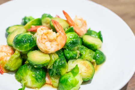 Delicious Stir-fried Brussels Sprouts with shrimp on dish. Close up Reklamní fotografie