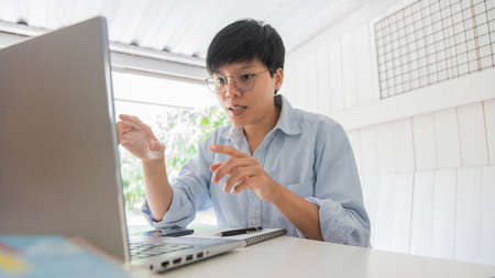 Asian teachers are teaching students online education, learning. conducted via electronic media He is explaining, to students studying at home during the quarantine COVID19, e-learning on a laptop.