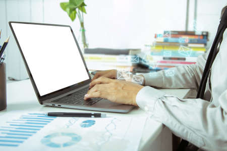 Close up. Newsletter concept. Hand of businessman checking message box on digital laptop working at home