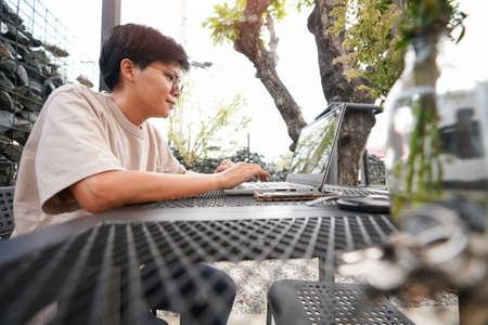 newsletter concept Asian businessman checking message box on digital laptop Vintage tone filter. 版權商用圖片