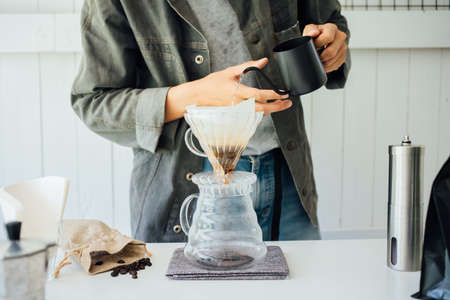 people making coffee for dripping hot coffee into the cup with equipment, tool brewing at kitchen home