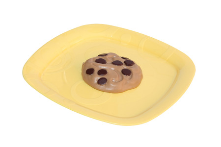 a cookie on a yellow dish