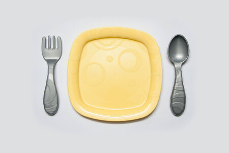 a dish with spoon and fork Stok Fotoğraf