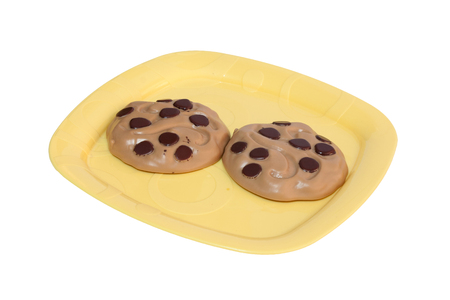 two cookies on a yellow dish