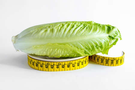 lettuce on a plate and meter, diet concept.