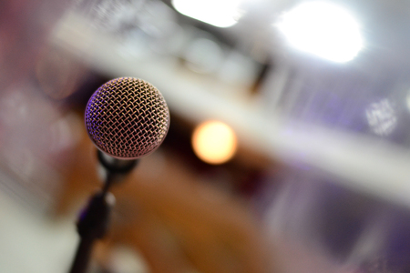 Close up microphone on stage in ball room. Condenser microphone.