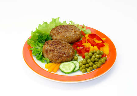cutlets: Cutlets in a plate with vegetables