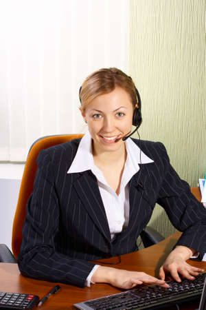 A friendly secretary/telephone operator in an office Stock Photo - 2590497