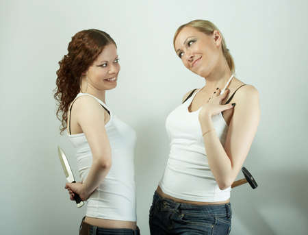 insincerity: Two hypocritical girls smile each other at a meeting Stock Photo