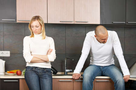 divorce: The image of quarrel of a married couple on kitchen Stock Photo