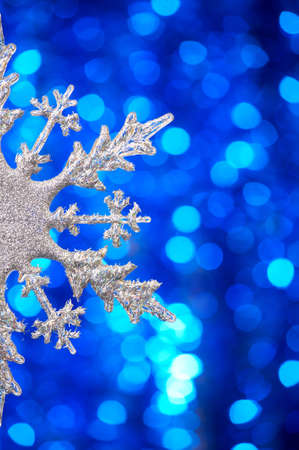 flickering: One silvery snowflake on a blue flickering background
