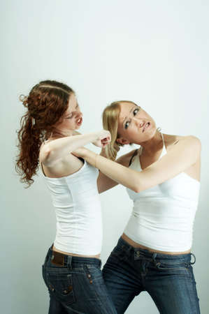 The image of fight of two girls because of the man isolated photo