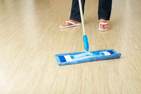 The cleaner washes a floor in premises photo