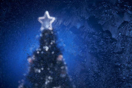 degradation: The New Year tree image behind frosty glass Stock Photo