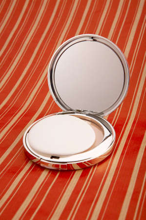 collapsible: Collapsible mirror on a bright background
