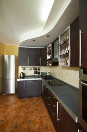 kitchens: Interior of modern kitchen in dark colour
