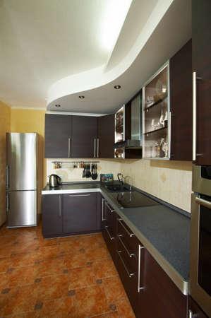 domestic appliances: Interior of modern kitchen in dark colour