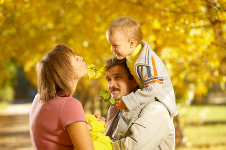 Family with children on walk in autumn park Stock Photo - 4205040