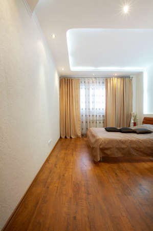Interior of the big bedroom in brown tones Stock Photo - 4295534