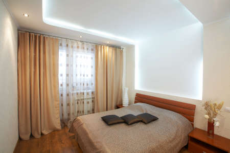 The image of a bedroom with original execution of a ceiling Stock Photo - 4417013