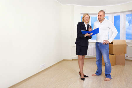 signing a contract: A man is signing a contract for buying a house Stock Photo